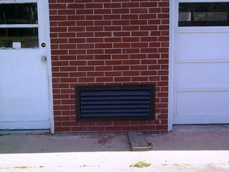 12x32 Flood Vent Installed On Brick Garage Crawl Space